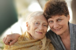 Portrait of happy old grandmother with daughter, closeup.