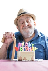 portrait of happy old man celebrating his birthday isolated on white background