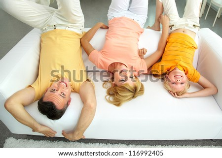 Portrait of happy parents and their daughter having fun