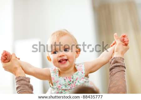 Portrait of happy playing baby at home