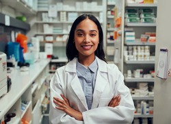 Portrait of happy professional female pharmacist in chemist