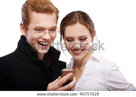 portrait of happy red-haired couple with cellphone on white