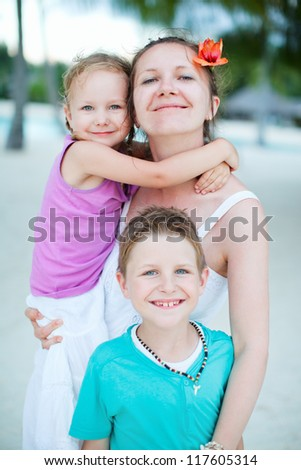 Portrait of happy relaxed family on vacation