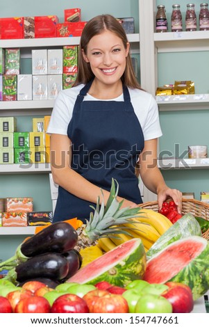 Portrait of happy saleswoman working at supermarket