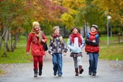 Portrait of happy schoolkids going to school