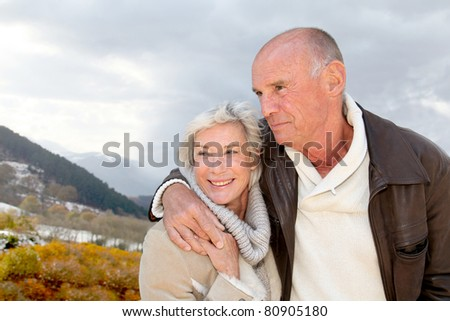 Portrait of happy senior couple at the mountain