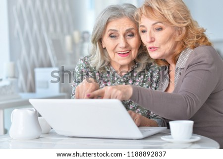Portrait of happy senior women using laptop #1188892837
