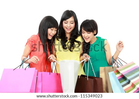 Portrait of happy shopping woman looking inside shopping bags