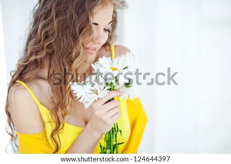Portrait of happy smiling beautiful young woman with bouquet flowers #124644397