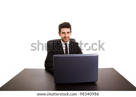 Portrait of happy smiling business man with laptop at office desk