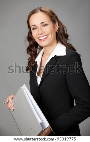 Portrait of happy smiling business woman with gray folder, over gray background