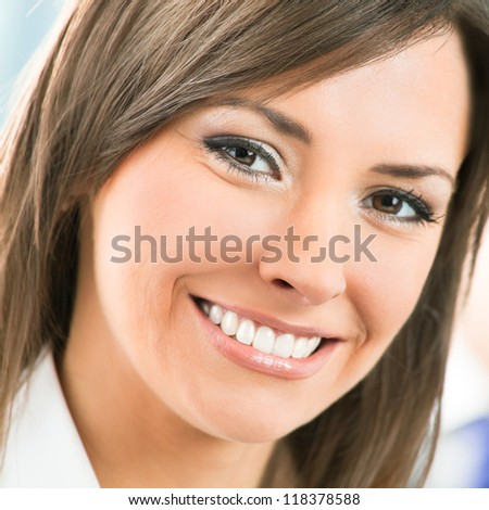 Portrait of happy smiling cheerful business woman at office