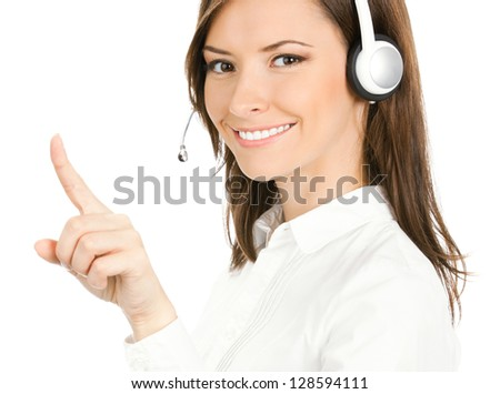 Portrait of happy smiling cheerful customer support phone operator in headset pointing at something, isolated over white background