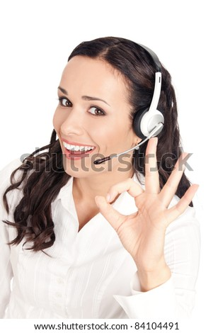 Portrait of happy smiling cheerful customer support phone operator in headset showing okay gesture, isolated on white background