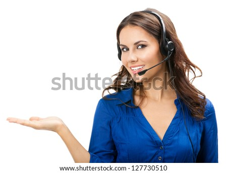 Portrait of happy smiling cheerful young support phone operator in headset showing copyspace area or something, isolated over white background