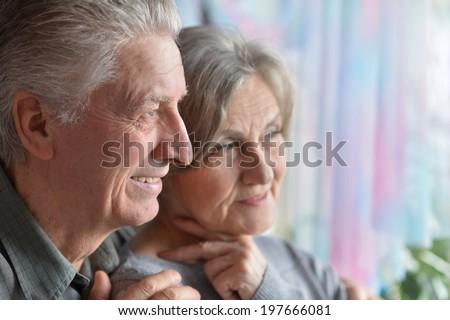 Portrait of happy smiling older pair closeup