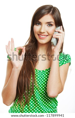 Portrait of happy smiling woman dressed in a green blouse, Isolated on white background use phone.