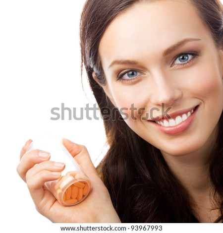 Portrait of happy smiling woman showing bottle with pills, isolated over white background