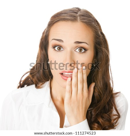 Portrait of happy smiling young business woman covering with hand her mouth, isolated over white background