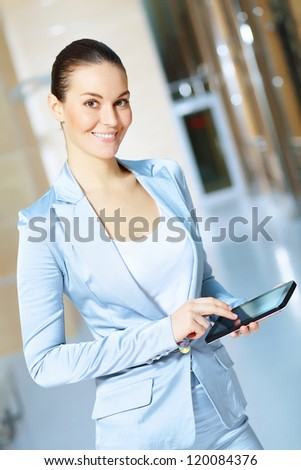 Portrait of happy smiling young businesswoman in office