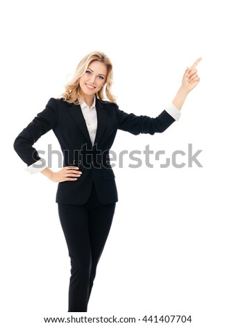 Portrait of happy smiling young cheerful businesswoman, showing something or blank copyspace area for slogan or text message, isolated against white background