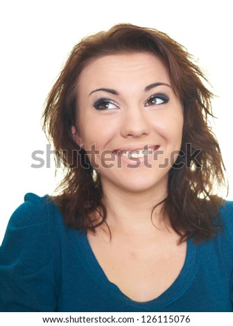 Portrait of happy smiling young woman in a blue shirt. Woman looking in the upper-right corner. Isolated on white background