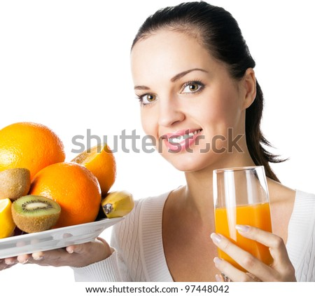 Portrait of happy smiling young woman with assorted citrus fruits and glass of orange juice, isolated over white background