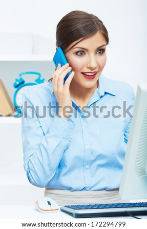 Portrait of happy surprised business woman on phone in white office. Young female model computer working.