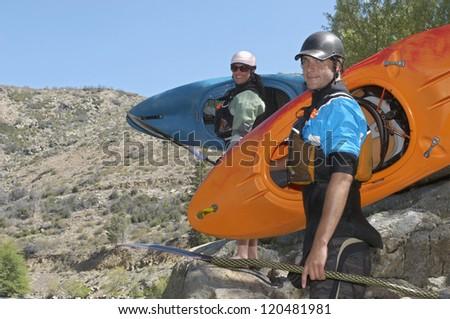 Portrait of happy teammates ready for kayaking - stock photo