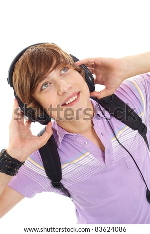 Portrait of happy teenage boy with headphones and backpack