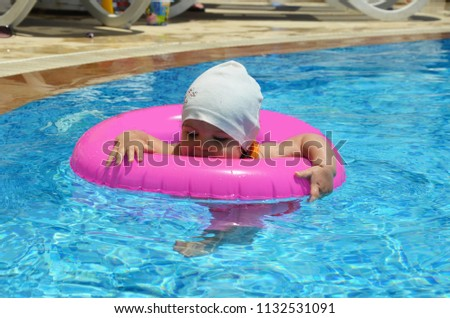 438eaf6a6c Portrait of happy white child baby girl toddler in swimming pool outdoor.  Preschool boy training