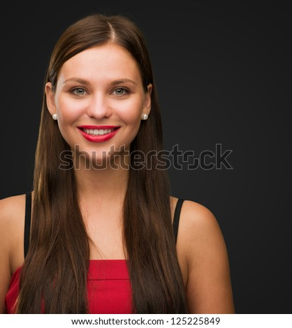 Portrait Of Happy Woman against a black background