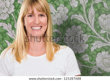Portrait Of Happy Woman against a vintage wall