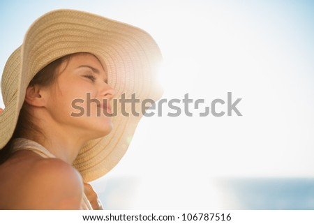 Portrait of happy woman enjoying sunshine