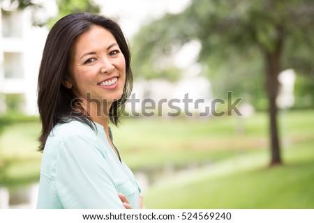 Portrait of happy woman outside.