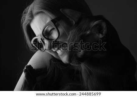 Portrait of happy woman with her cat #244885699