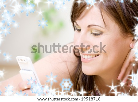 portrait of happy woman with white phone (focus on smile)