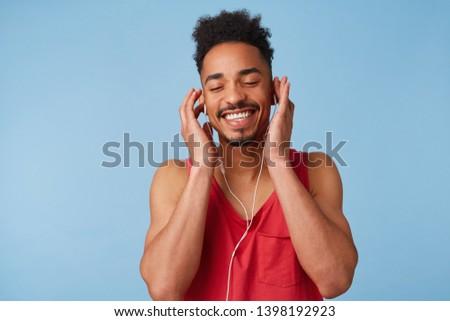 Young Boy Wearing Headphones Listening Music In Studio