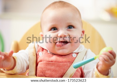 Shutterstock Portrait Of Happy Young Baby Boy In High Chair