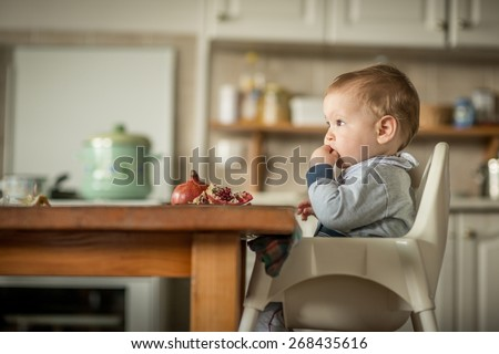 Portrait Of Happy Young Baby Boy In High Chair Stock foto ©