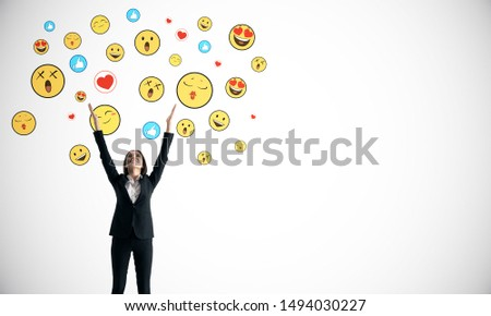 Portrait of happy young businesswoman with emotive on subtle white background. Communication and emotion concept