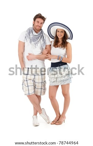 Portrait of happy young couple in summer outfit, looking at camera, smiling, isolated on white background.?