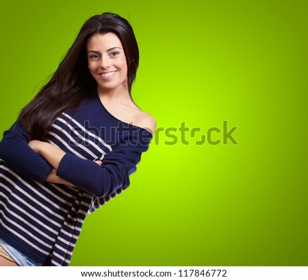 Portrait Of Happy Young Girl On Green Background