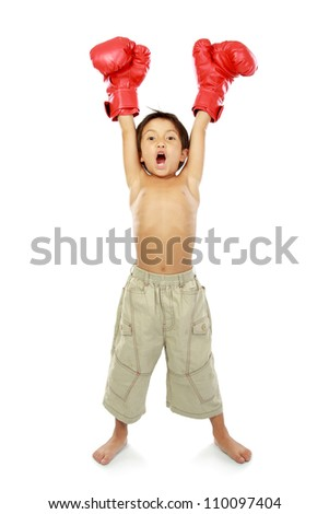portrait of happy young kid with boxing glove in winning pose