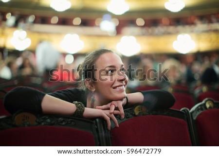 Portrait of happy young woman in auditorium of opera teatre Zdjęcia stock ©