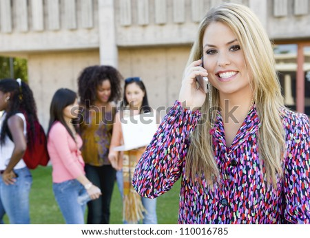 Portrait of happy young woman on call