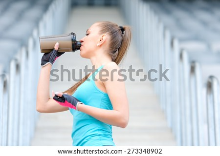 Shutterstock Portrait of healthy fitness girl drinking protein shake. Woman drinking sports nutrition beverage while working out