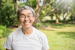 Portrait of healthy happy senior asian old man in the park outdoors with copy space. Spring healthcare lifestyle grandfather retirement concept