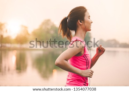 Portrait of healthy woman runner legs running exercise jogging on road, Woman fitness jog workout in the park during sunset #1354077038