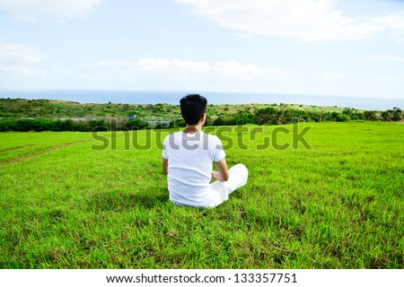 portrait of healthy young man doing yoga back